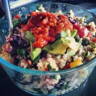 Mediterranean Quinoa Bowl with kalamata olives, veggies, eggplant salsa, and avo.